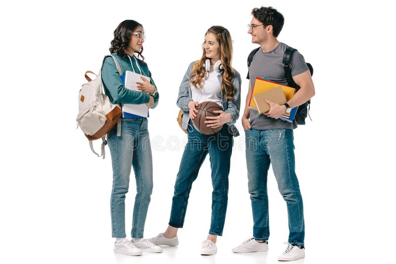 multicultural students with books and basketball ball stock photography