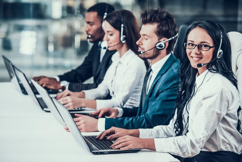 Multicultural young happy employees in call center stock images