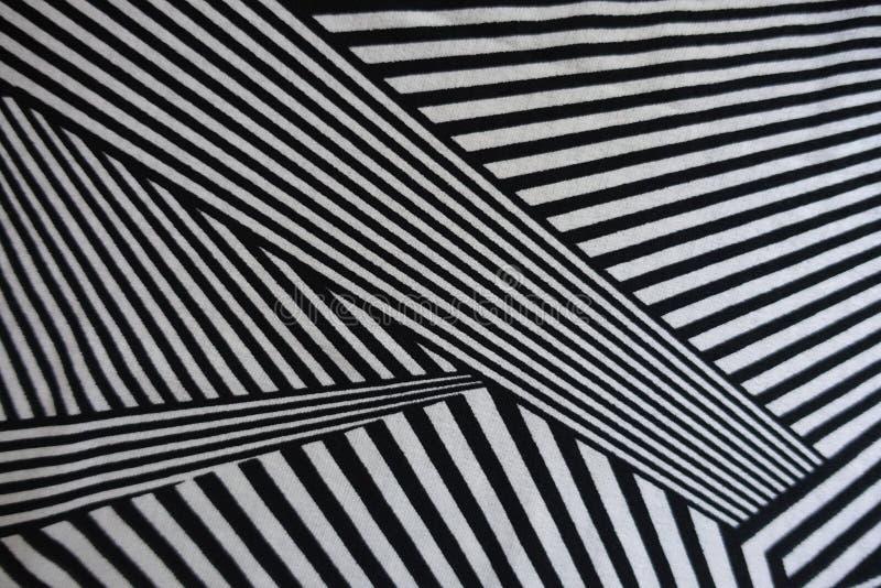 Multidirectional linjer tryck på tyg arkivbilder