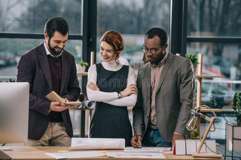 multiethnic architects discussing work royalty free stock photo