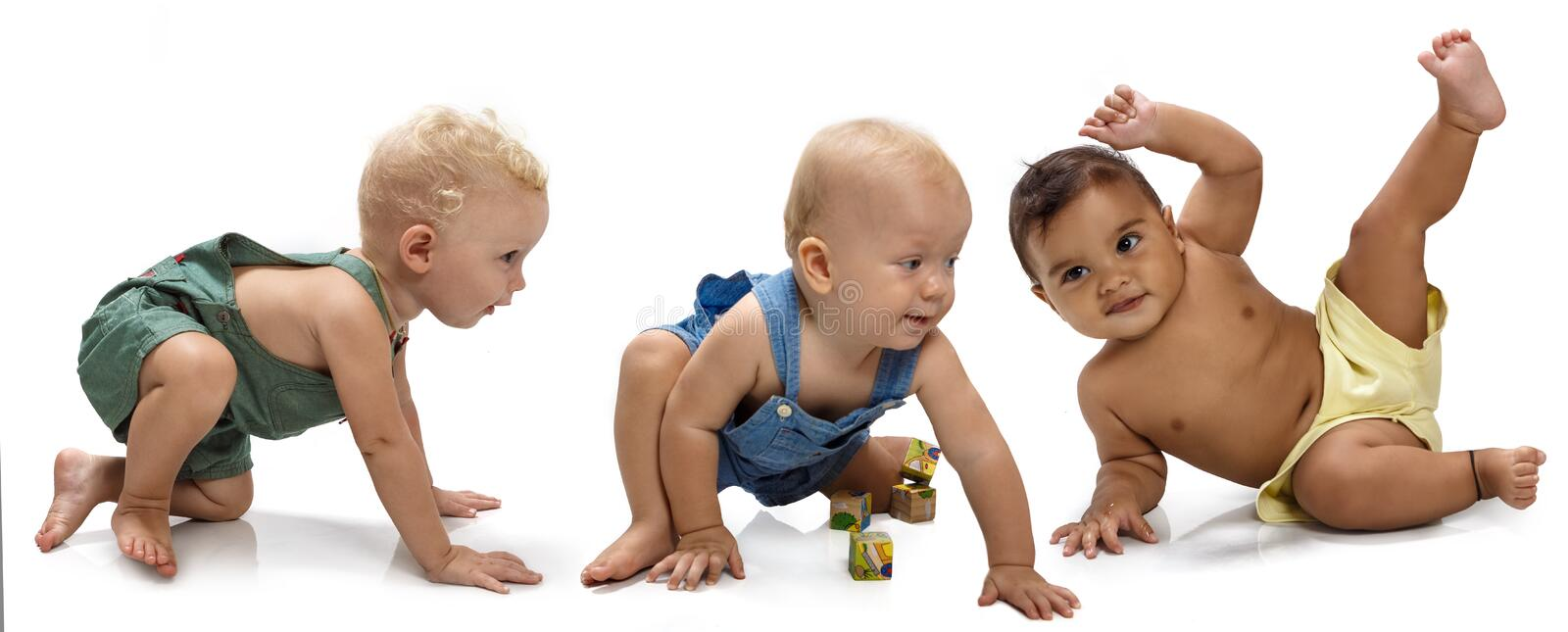 Multiethnic babies. Dancing on light background stock images