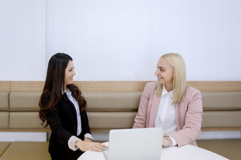 Multiethnic business colleagues having a meeting royalty free stock images