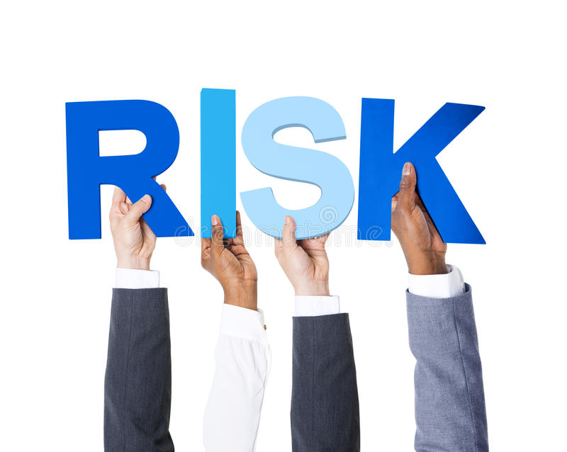 Multiethnic Business People Holding the Word Risk.  royalty free stock image