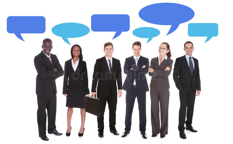 Multiethnic business people with speech bubbles stock image