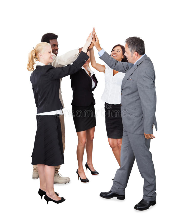 Multiethnic business team joining hands over white background royalty free stock photos