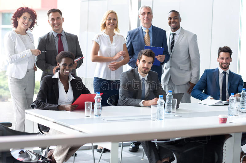 Multiethnic business team posing in company stock image