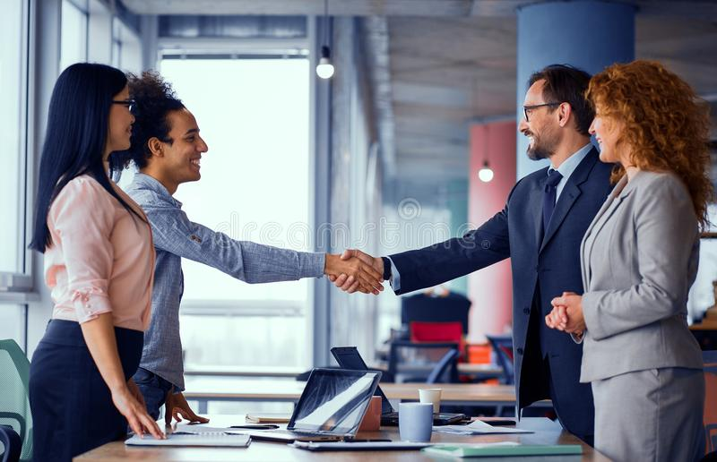 Multiethnic business teams at meeting room shaking hands. royalty free stock photography