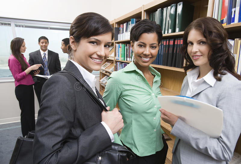 Multiethnic Businesspeople In Library royalty free stock image