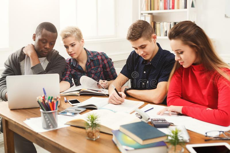 Multiethnic classmates preparing for exams together royalty free stock photos