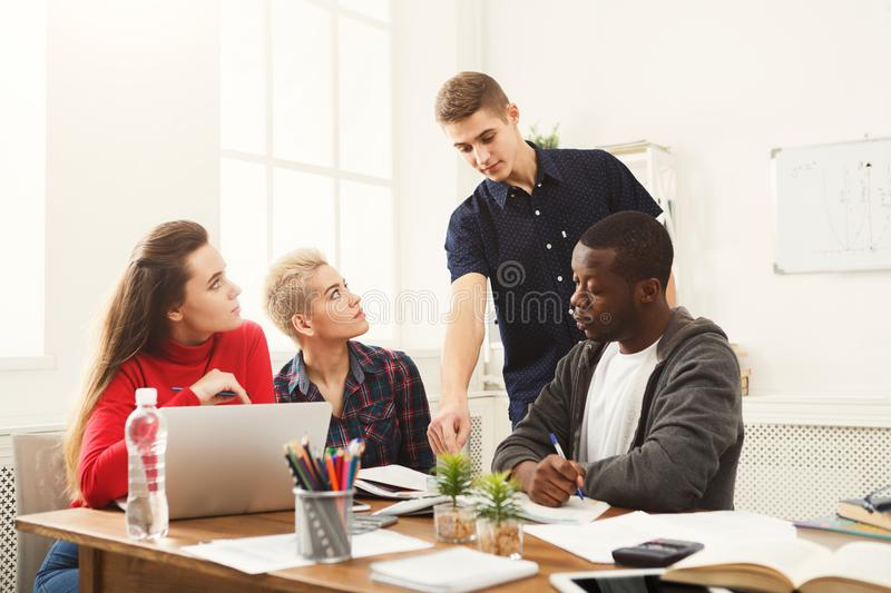 Multiethnic classmates preparing for exams together royalty free stock images