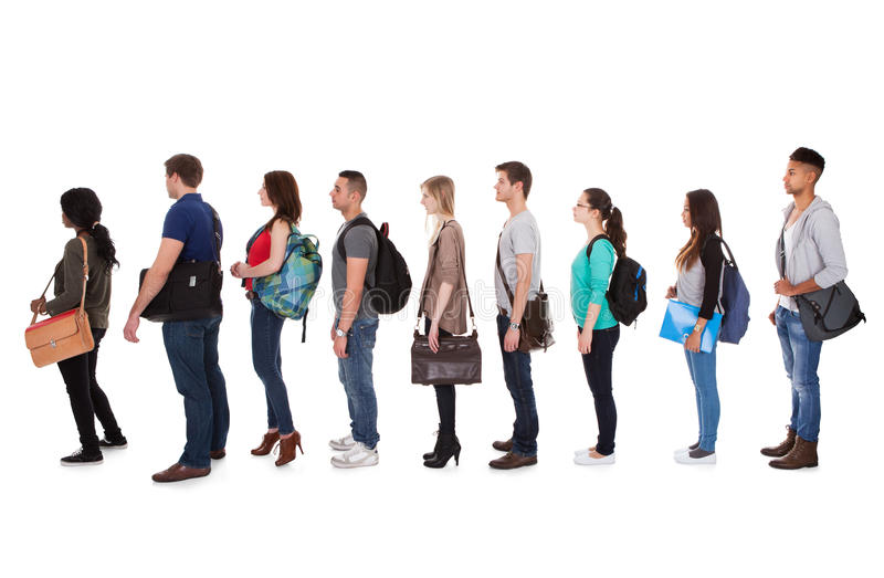 Multiethnic college students standing in a row royalty free stock image