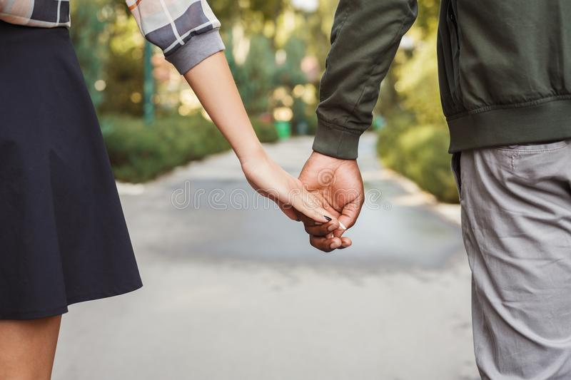 Multiethnic couple in love walk in park closeup royalty free stock images