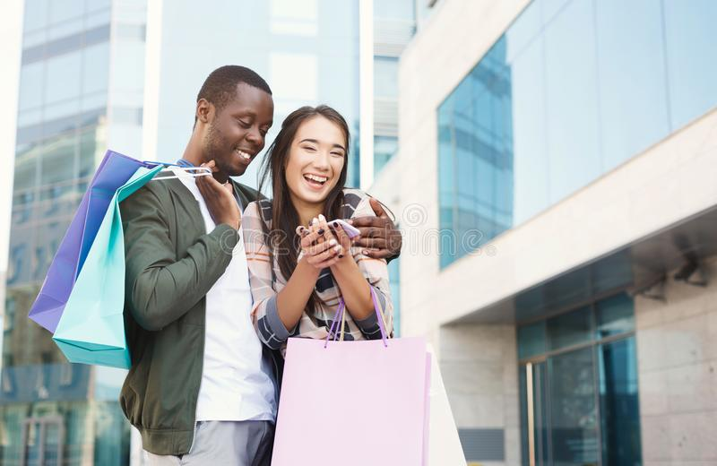 Multiethnic couple shopping together stock photography