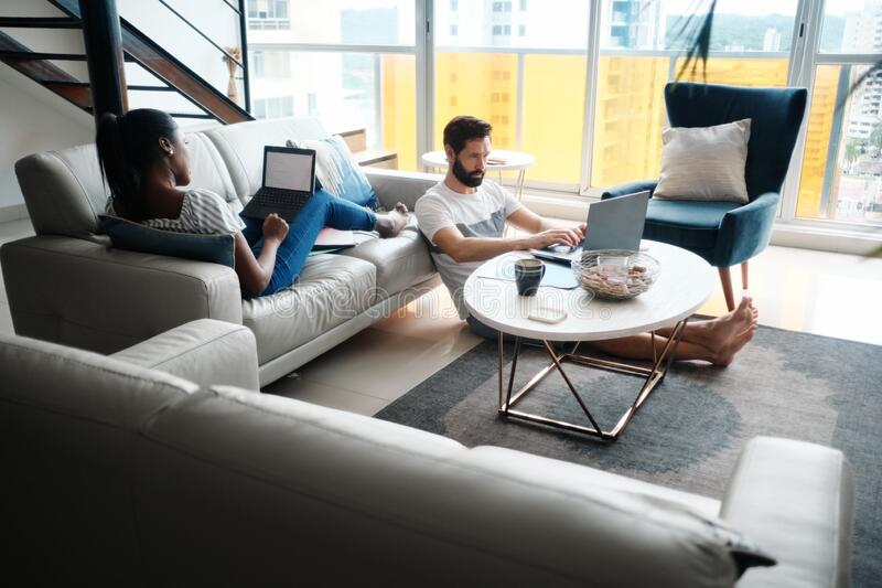 Couple Working And Playing With Laptop Computer At Home stock photography