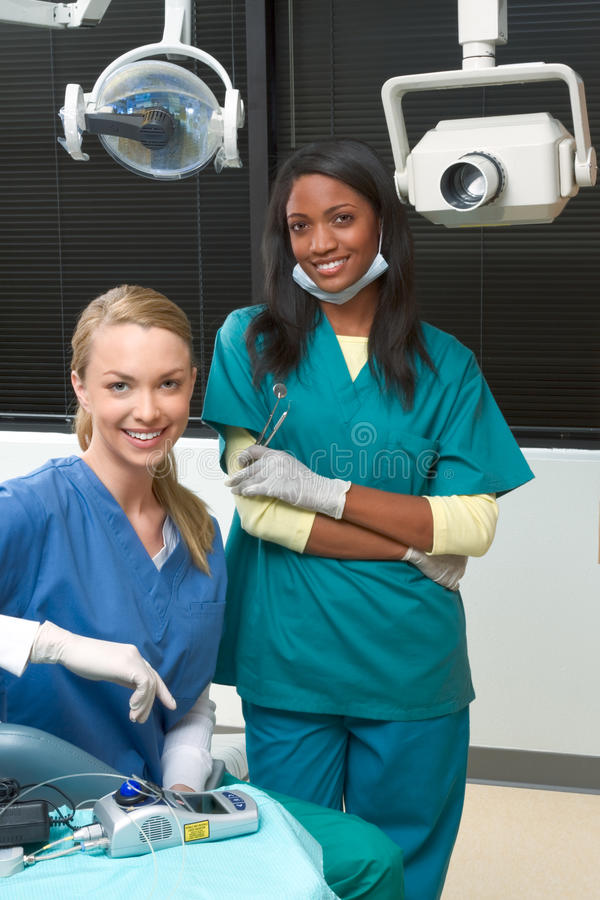 Multiethnic dentist office Caucasian and black stock image