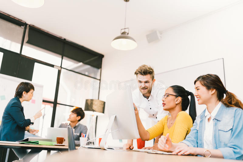 Multiethnic diverse group of people at work. Creative team, casual business coworker, or college students in brainstorm meeting stock photography