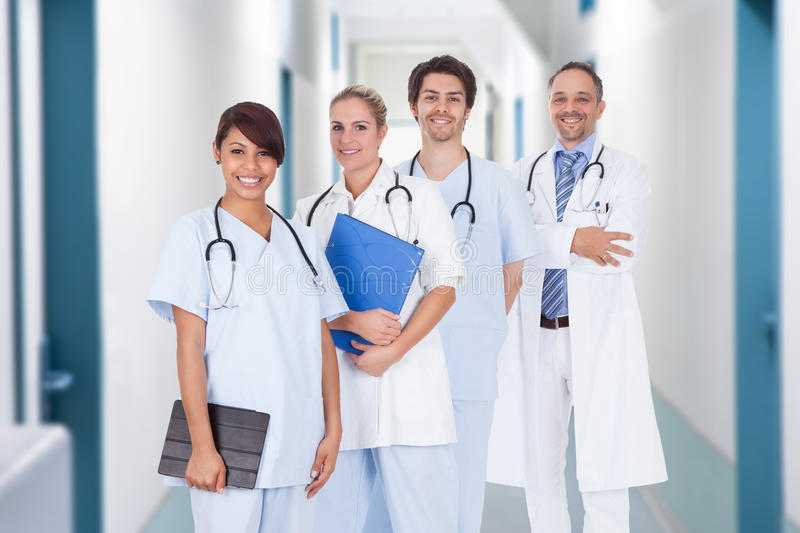 Multiethnic doctors with stethoscopes around neck in hospital stock images