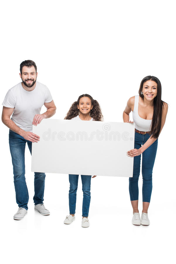 Multiethnic family holding blank banner isolated on white stock photography