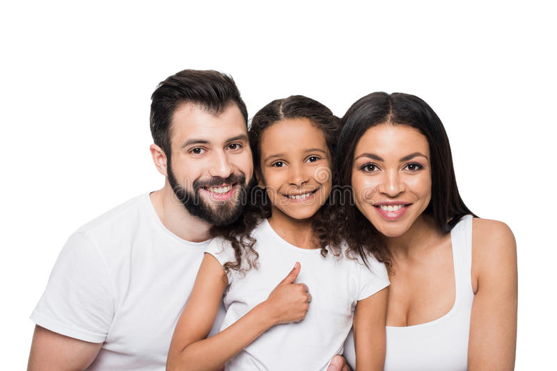 Multiethnic family showing thumb up and smiling at camera stock photography