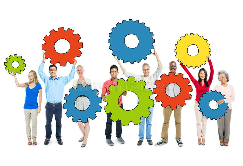 Multiethnic Group of People Holding Gears royalty free stock image