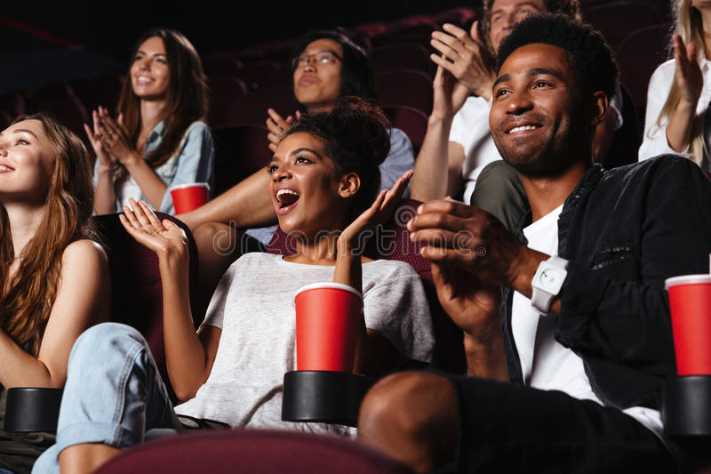 Multiethnic happy audience clapping hands royalty free stock image