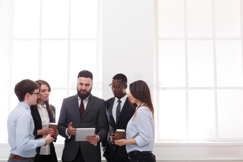 Corporate meeting of employees with boss in office, business people with copy space royalty free stock images