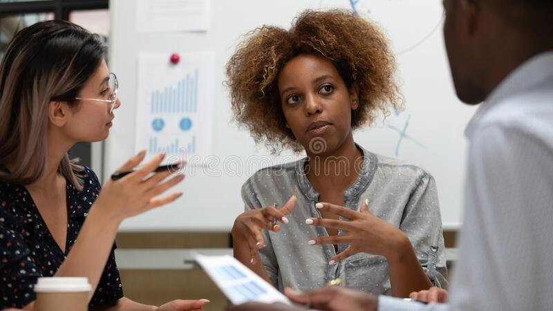 Multiethnic diverse colleagues brainstorm at company briefing royalty free stock photography