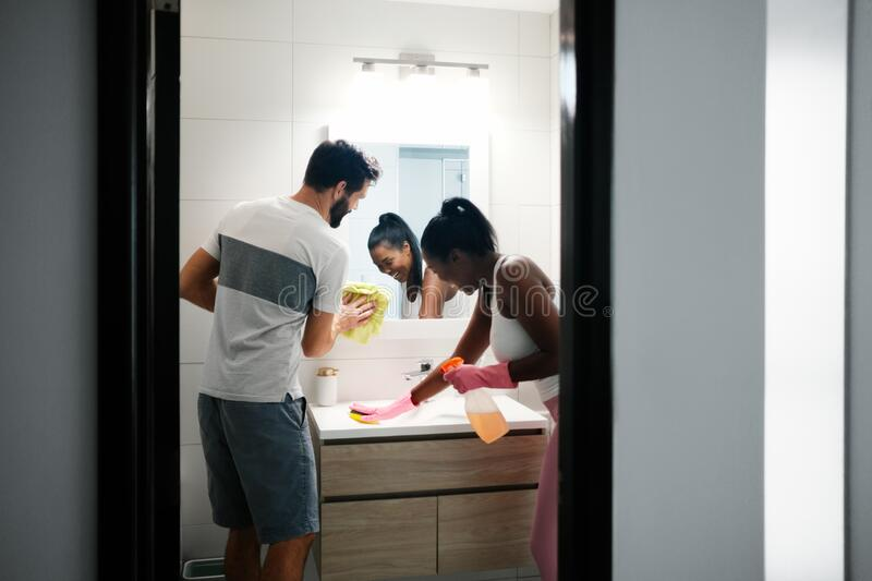 Multiethnic People Doing Chores Cleaning Home Bathroom royalty free stock images