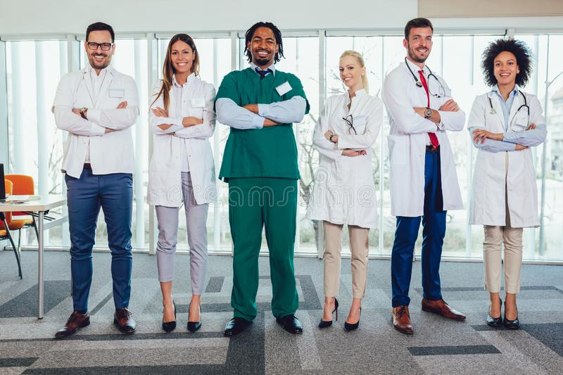 Multiethnic team of doctors in hospital looking at camera royalty free stock images