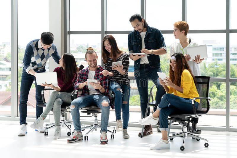 Multiethnic team of happy business people working together, meeting and brainstorming in office royalty free stock photos