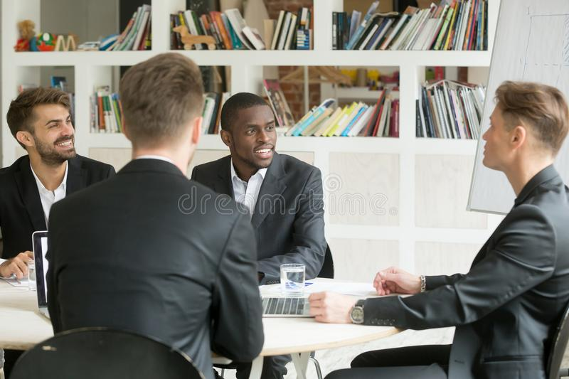 Multiethnic team of male coworkers discussing corporate plans du stock photos