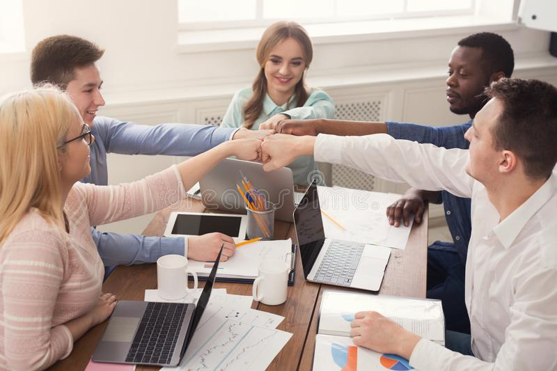 Teamwork and teambuilding, people connect hands. Multiethnic team put hands together, connection, teambuilding and alliance concept. People in office unite for royalty free stock image