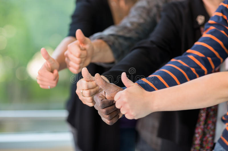 Download Multiethnic University Students Gesturing Thumbsup Stock Photo - Image of cropped, friendship: 37134078