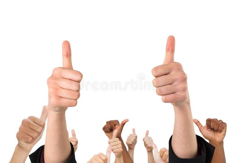 Multiethnische Hände schlagen oben stockfoto