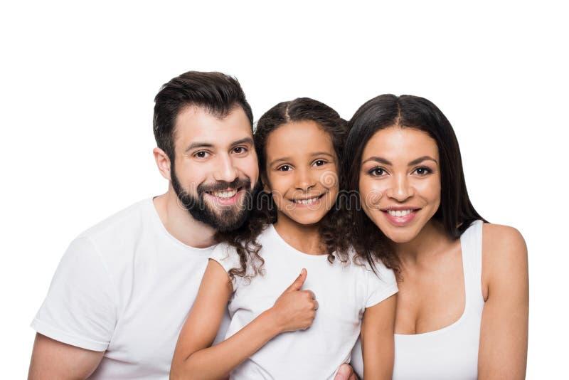 Multietnisk familjvisningtumme som är övre och ler på kameran arkivbild