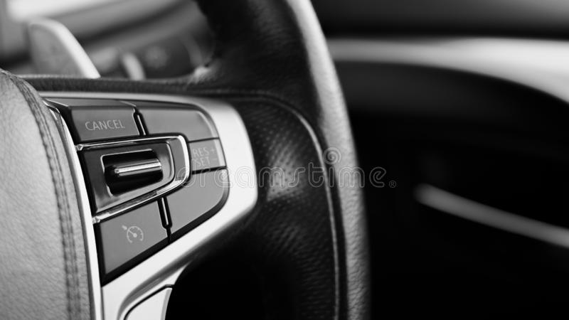 Multifunction buttons for quick control at a black steering wheel royalty free stock photos