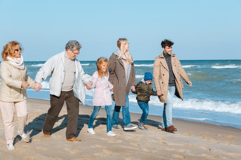 multigenerational family holding hands stock photo