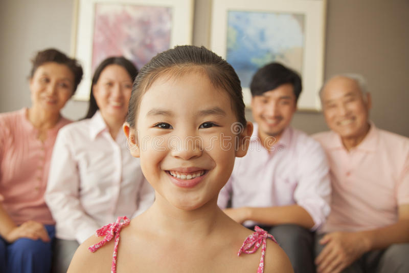 Multigenerational family smiling, portrait stock photography