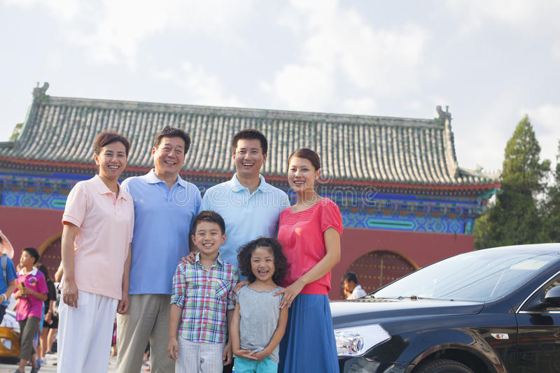 Multigenerational family smiling, portrait, outdoors in Beijing stock photography
