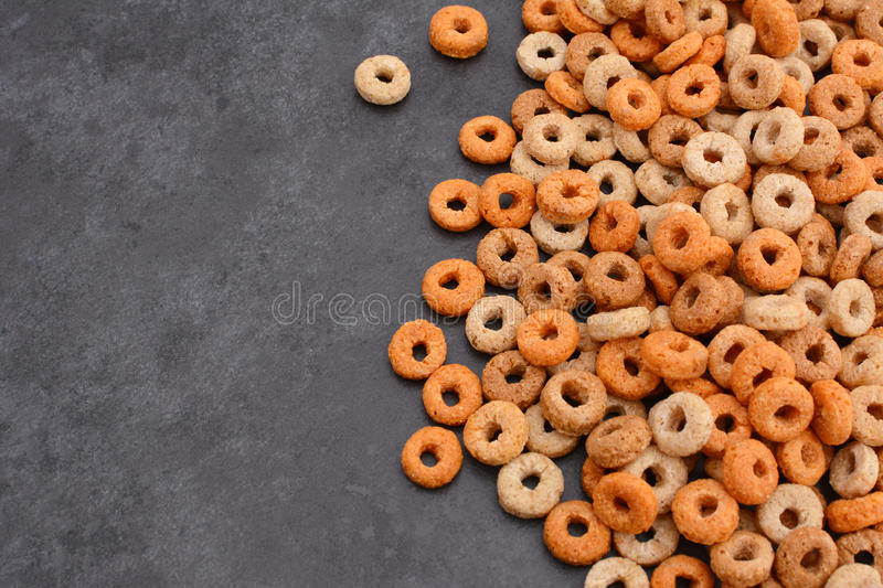 Multigrain hoops breakfast cereal on grey slate background stock photography