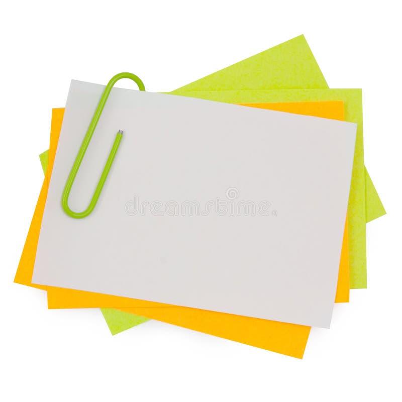 Multikleurennota met Groene paperclip royalty-vrije stock fotografie
