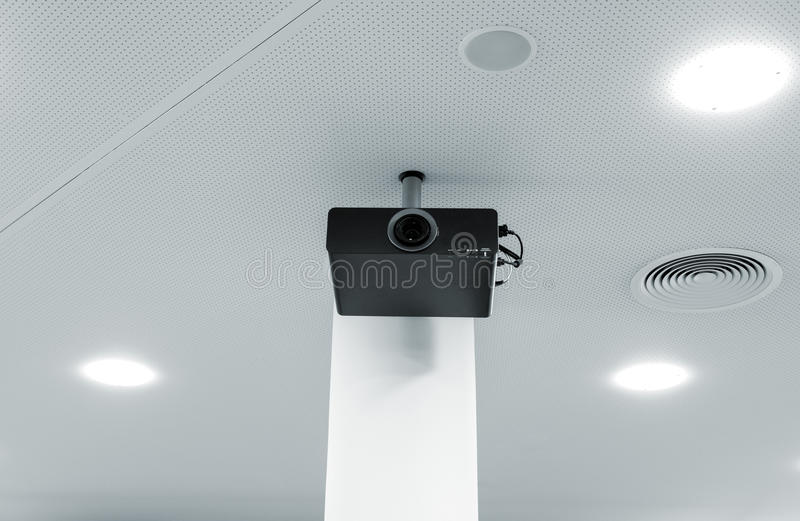 Multimedia projector on the ceiling royalty free stock images