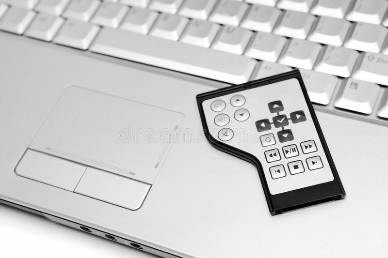 Multimedia Remote Control And Laptop Pc Stock Photos