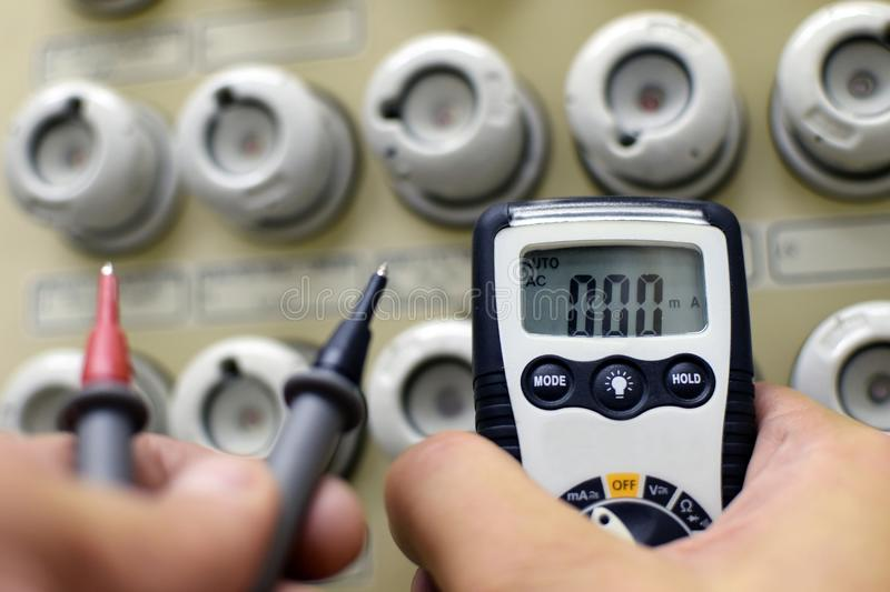 Multimeter and fuse box stock photo
