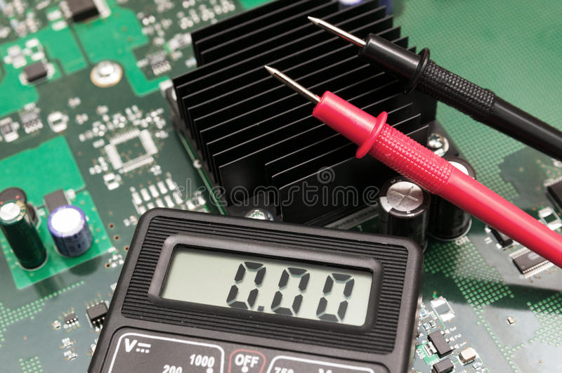 Multimeter on PCB plate. Close-up multimeter on PCB plate royalty free stock image