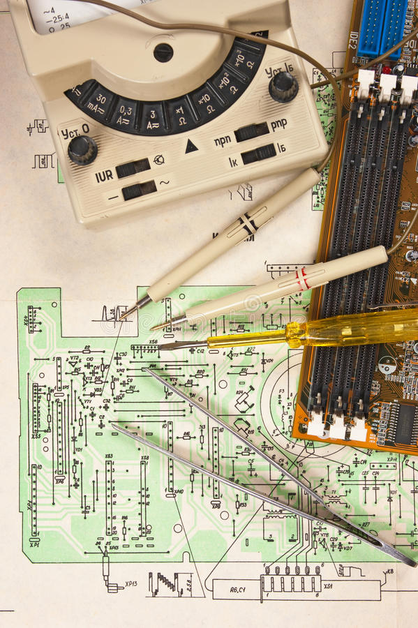 Multimeter on wiring diagram royalty free stock photography