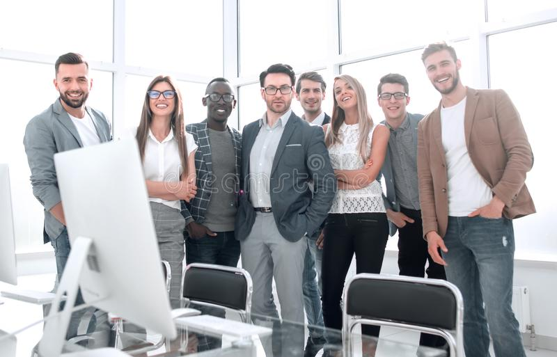 Multinational business team standing in a bright office stock images