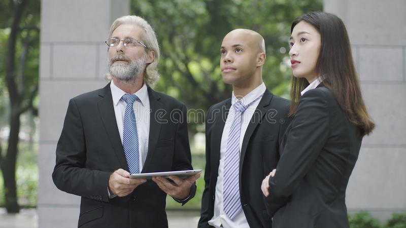 Three corporate executives looking up stock photography