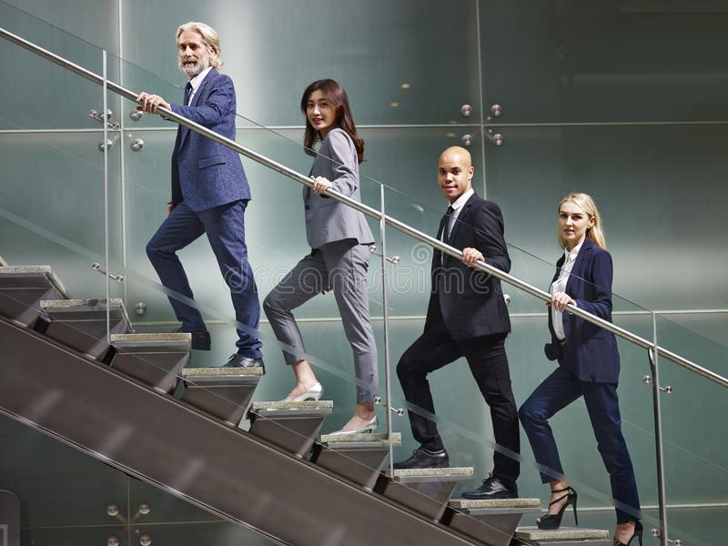 Multinational and multiethnic corporate business people lined up stock photography