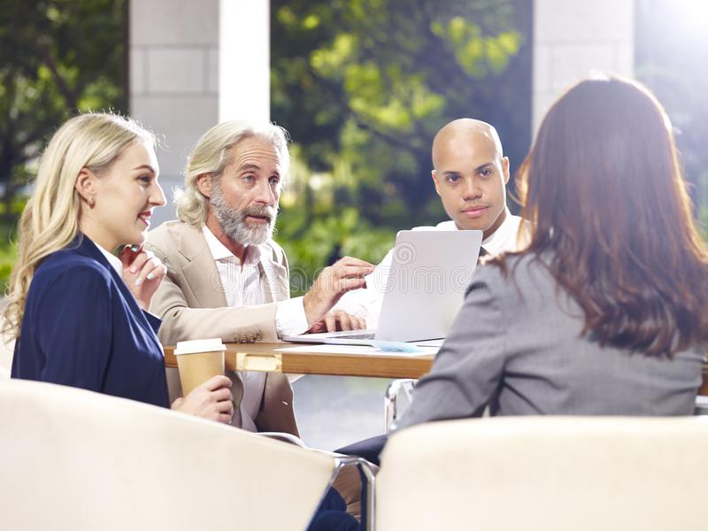 Multinational and multiethnic corporate business people meeting stock photography